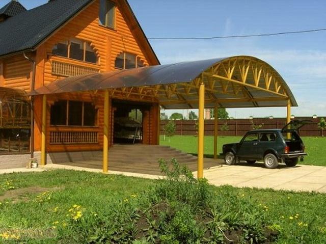 Красивый навес над крыльцом частного дома - фото, дизайн, цена установки 4